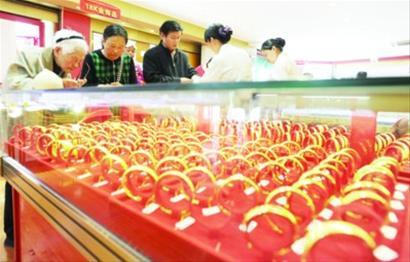 黄金价格预计继续震荡 高估低渣策略