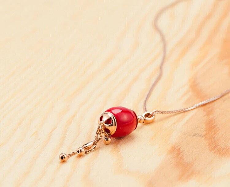 潮宏基鼓韵系列鼓之意18K金红瓷珠吊坠图片_珠宝图片