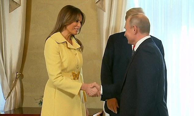 梅拉尼娅与普京握手后表情异样 像被吓坏了