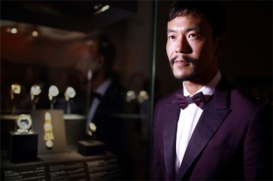 廖凡身着杰尼亚高级手工系列晚礼服现身沪上时尚活动
