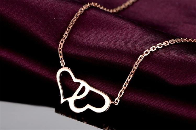 米莱珠宝白18K金心形双环结婚钻石项链_珠宝图片