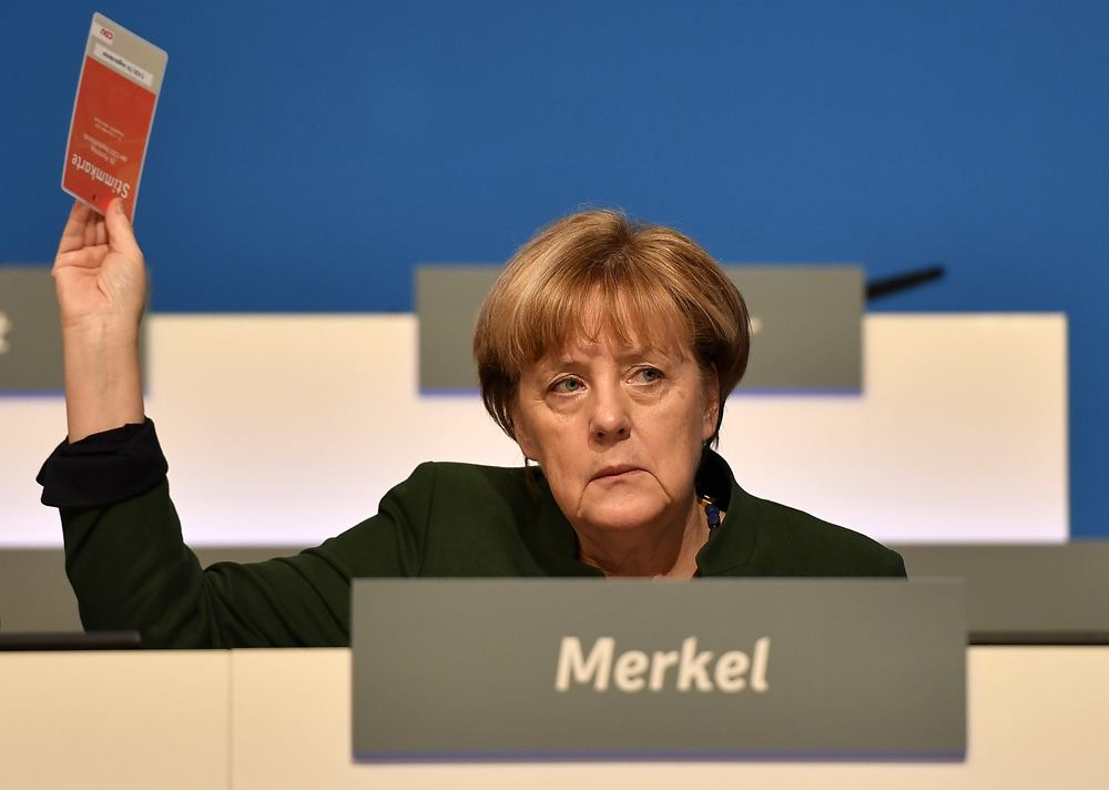 """默克尔有望""""梅开四度"""" 全球威胁即将来临?"""