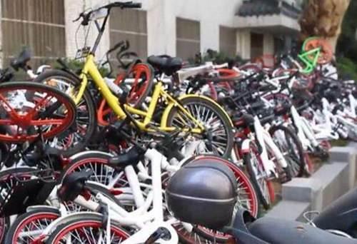 共享单车垃圾成山 摩拜与ofo的态度不置可否