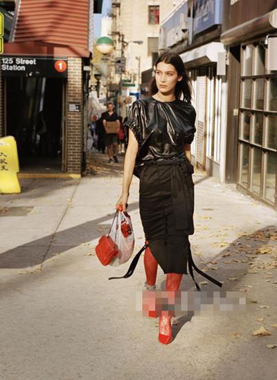 欧美明星服装流行趋势示范 红黑大撞色轻松夺人眼球