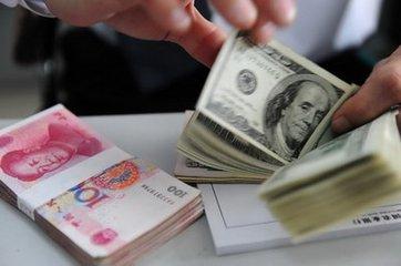 6月20日人民币兑美元中间价调贬124个基点