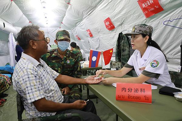 中国医疗队空前规模访问老挝 并称两国加强合作是必然事件
