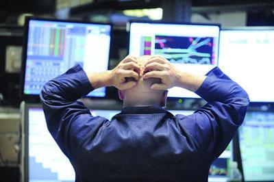 受科技股拖累 美股道指从纪录高点回落