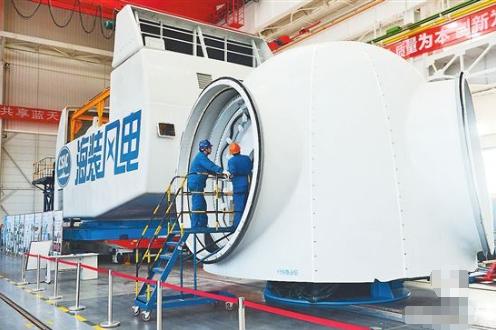 重庆首台3MW风力发电机组进行最后组装测试 扫风面积全球最大