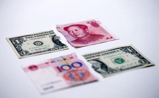 人民币对美元汇率平静表面下暗藏玄机?