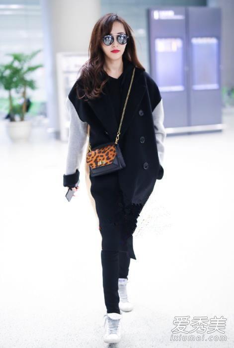 唐嫣最新机场街拍造型 大衣+卫衣叠穿满满高级感