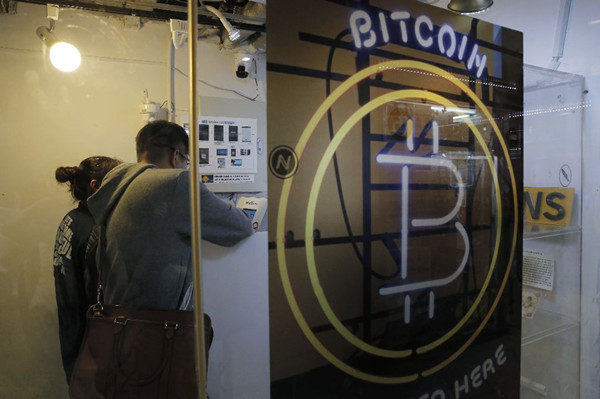 比特币狂热席卷全球 连ATM机都有了!