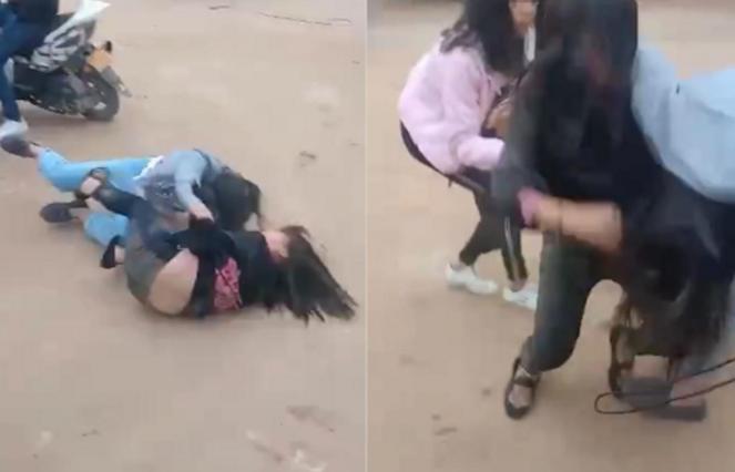 湖南两女生校门口厮打 整个过程无人劝阻