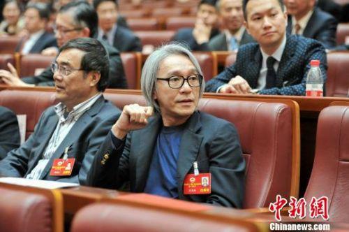 周星驰出席政协会议 表示目前关注文化创意产业发展