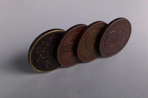 这枚梅花5角硬币价值500 是不是真的?