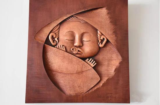 和金平:木雕非物质文化遗产传承人