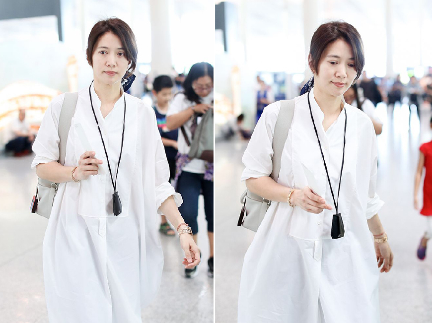 47岁袁咏仪穿白色衬衫裙现身机场 然而手上37万的腕表才叫真高调