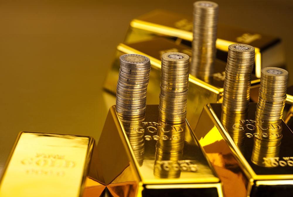 现货黄金形成三角旗形态 盯紧这一关键阻力位